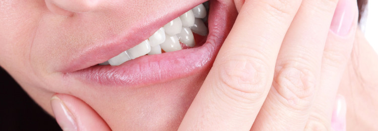 К чему болят зубы — примета